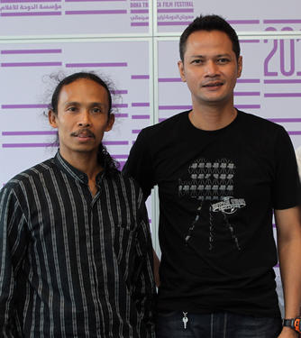 Yayan Ruhian and Ray Sahetapy at the photocall of 2011 Doha Tribeca Film Festival in Qatar.